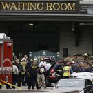 Emergency officials stand outside the Hoboken Terminal following a train crash (AP)