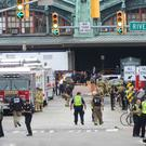 Emergency personnel respond to the Hoboken railway station after a crashed that killed one person and injured more than 100 (The Record/AP)