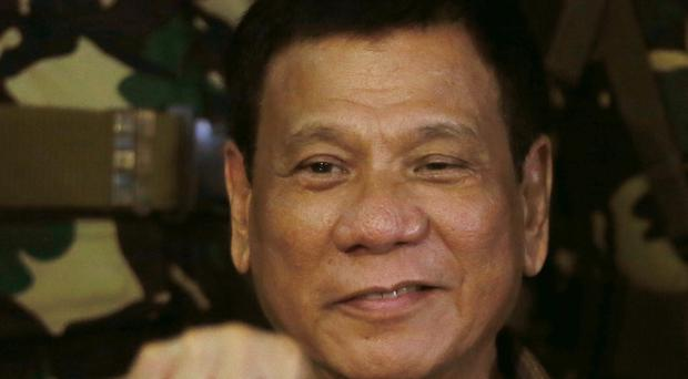 Philippines President Rodrigo Duterte discussed his anti-drugs campaign with Vietnamese leaders (AP)