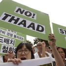 South Koreans opposed to deployment of the US Terminal High-Altitude Area Defence - THAAD - protest outside the Defence Ministry in Seoul (AP)