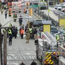 Emergency personnel at the scene after the train crash in Hoboken, New Jersey (AP)