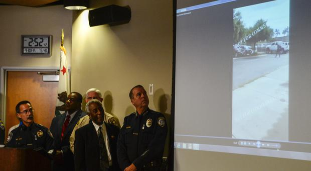 Police watch a video of the shooting of Alfred Olango, at a news conference in El Cajon (AP)