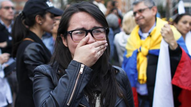 A supporter of the peace accord expresses shock after it was narrowly rejected in a referendum (AP)