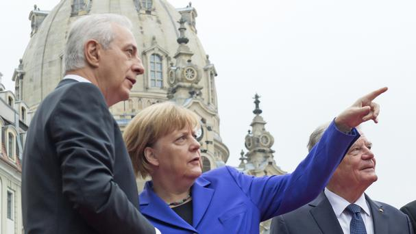 German Chancellor Angela Merkel attended at service at Frauenkirche cathedral in Dresden as the country celebrated the 26th anniversary of its reunification (AP)