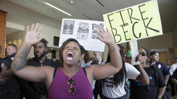 Protesters demand the firing of Los Angeles Police Chief Charlie Beck over the shooting of a black man over the weekend (AP)