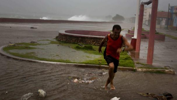 Waves pound the waterfront in Baracoa, Cuba (AP)