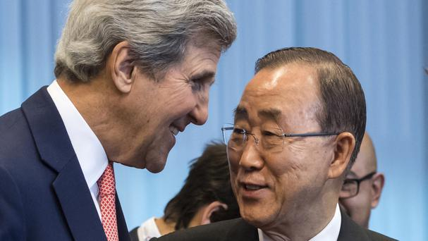 John Kerry with Ban Ki-moon at the aid conference in Brussels (AP)