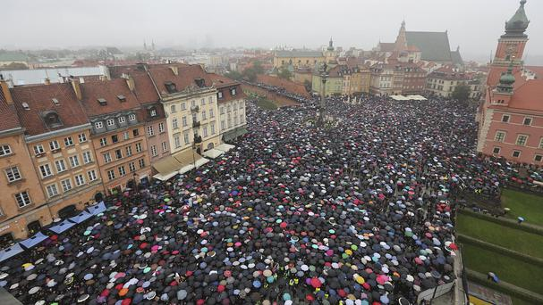 A sea of thousands of umbrellas as women and men participate in the demo (AP)