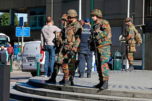 Soldiers stand guard during a bomb alert at the Gare du Nord train station in Brussels Picture: AFP/Getty