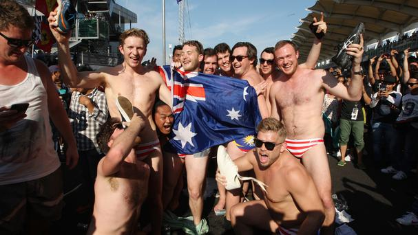 Australian men pose at the conclusion of the Malaysian Formula One Grand Prix in Sepang (AP)