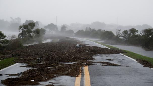 Debris litters a road on St Simons Island, Georgia (AP)