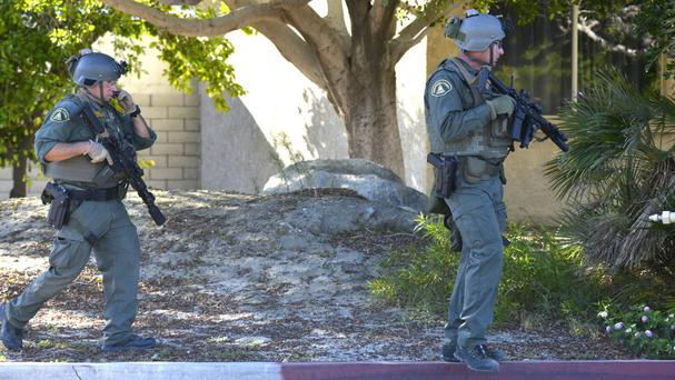Police hunt for the suspect after the shooting in Palm Springs (AP)