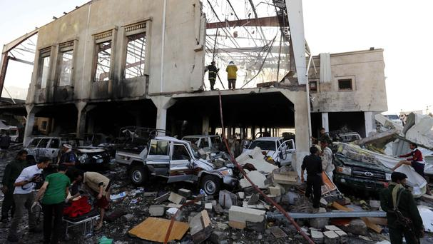 The aftermath of the air strike in Sanaa (AP)
