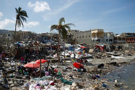 People gather at the shore after Hurricane Matthew passes in Jeremie, Haiti