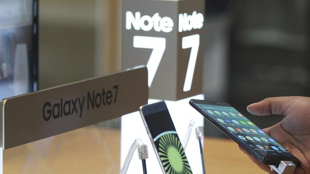A customer tries out a Samsung Galaxy Note 7 smartphone at the company's shop in Seoul in South Korea (AP)