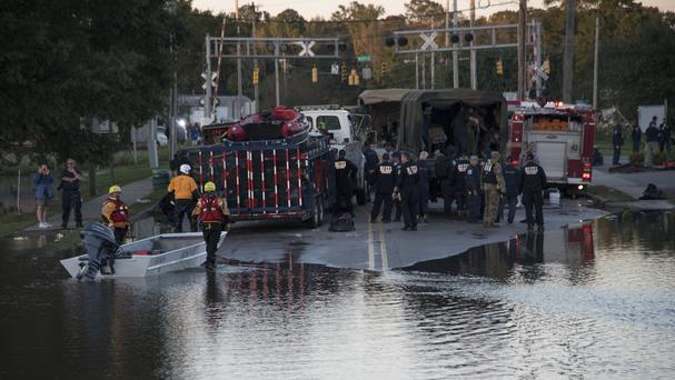 Rescue teams gather in Lumberton, North Carolina (AP)