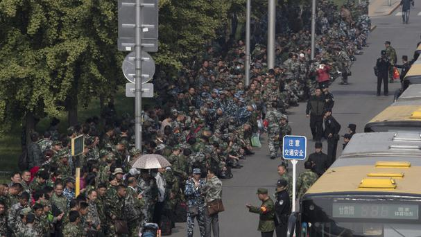 Protesters gather outside the Chinese Ministry of National Defence to protest in Beijing (AP)