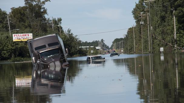 A lorry submerged in floodwaters caused by rain from Hurricane Matthew in Lumberton, North Carolina (AP)
