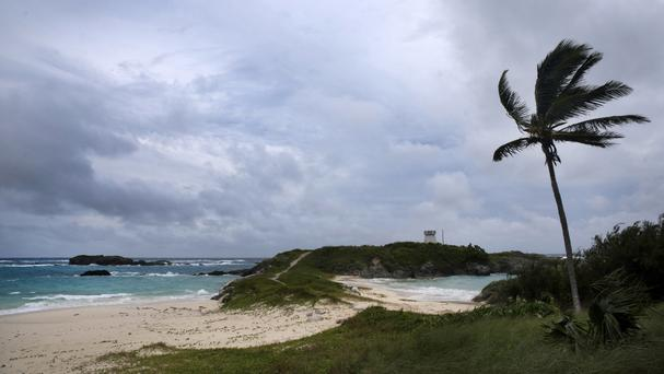Wind and surf pick up as Hurricane Nicole approaches the Coopers Island Nature Reserve in St Georges, Bermuda (AP)