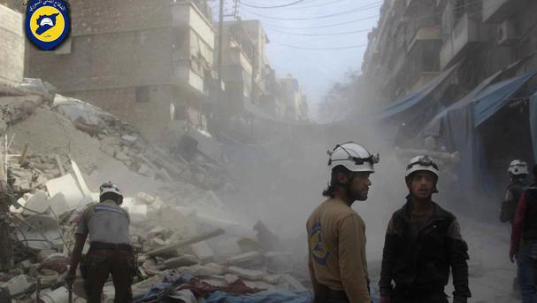 Syrian Civil Defence workers search through rubble in rebel-held eastern Aleppo (AP)