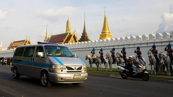 A van carrying the body of King Bhumibol Adulyadej arrives at the Grand Palace in Bangkok (AP)