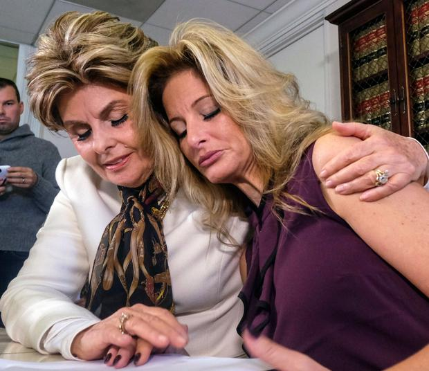 Attorney Gloria Allred, left, comforts Summer Zervos during a news conference in Los Angeles