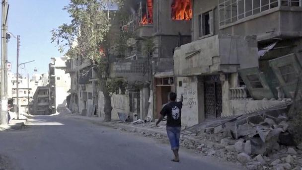 A house on fire in Aleppo Photo: Doctors Without Borders/AP