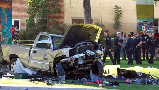 The truck that landed at Chicano Park after it flew off a ramp to the San Diego Coronado Bridge (Hayne Palmour IV/The San Diego Union-Tribune via AP)