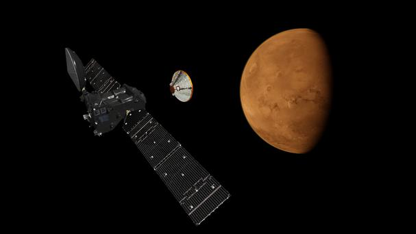 An artist's impression of the Schiaparelli lander detaching from the ExoMars Trace Gas Orbiter (European Space Agency)
