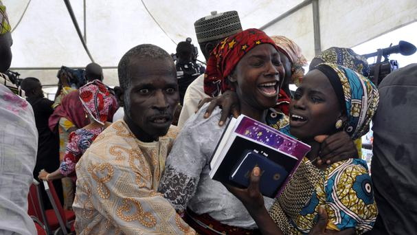 One of the kidnapped girls celebrates with family members in Abuja, Nigeria (AP)