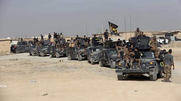 Iraq's elite counter-terrorism forces gather ahead of an operation to re-take the IS-held city of Mosul (AP)