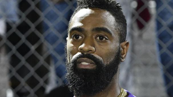 Former Olympic sprinter Tyson Gay speaks to mourners gathered in memory of his daughter Trinity (AP)