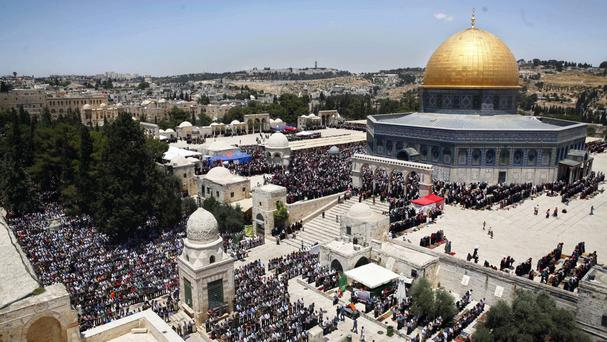 Palestinians pray in the Al Aqsa Mosque compound in Jerusalem's Old City (AP)