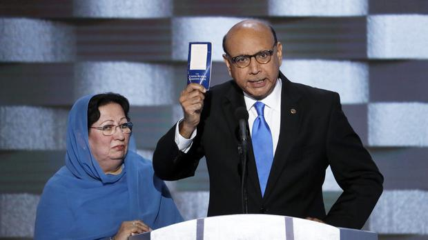 Khizr Khan, with his wife, who features in a TV ad targeting Donald Trump