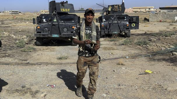 Iraq's elite counter-terrorism forces deployed in the town of Bartella, east of Mosul (AP)