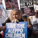 Children join demonstrators outside the gates of Downing Street during a protest to highlight the high numbers of children killed in bombings in Syria
