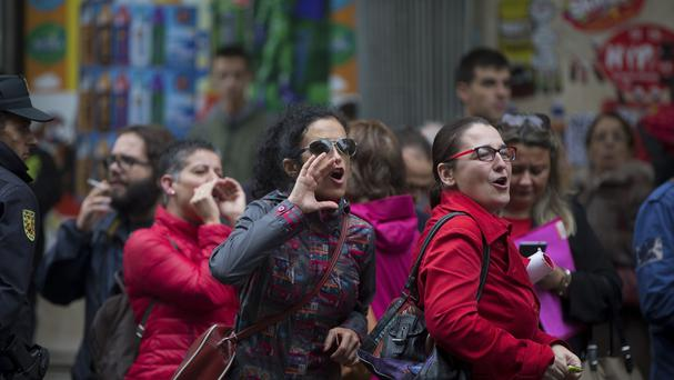 Socialist party supporters shout during a protest against the its possible support for a conservative government in Madrid, Spain (AP)