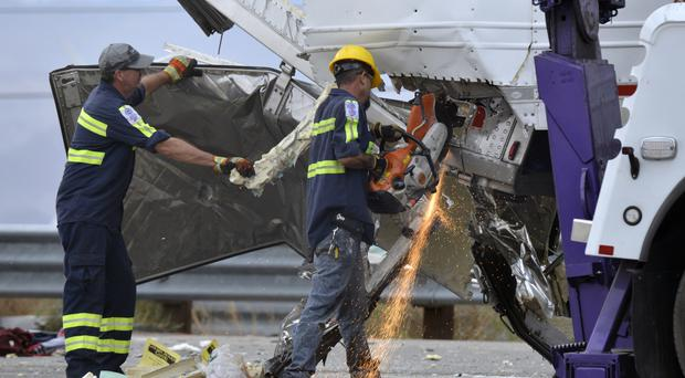 Emergency services work at the scene of the crash on Interstate 10, near Palm Springs, California (AP)