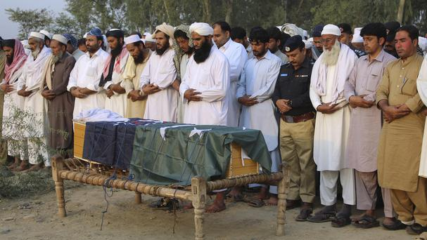 Local residents offer the funeral prayer of an intelligence officer in Charsadda, Pakistan. (AP)