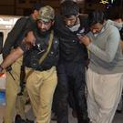 A Pakistani volunteer and a police officer rush an injured person to hospital in Quetta (AP)