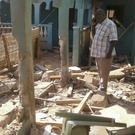 A man stands amid the debris at the scene of an attack in the town of Mandera (AP)
