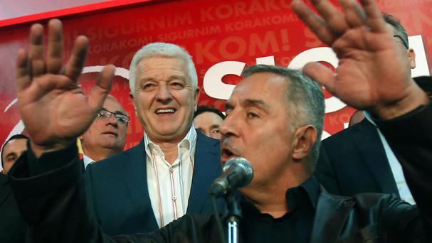 Milo Djukanovic, front, speaks at his headquarters in Podgorica as Dusko Markovic looks on (AP)