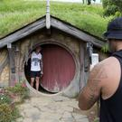 Tourists take photos during a tour of the Hobbit movie set near Matamata, New Zealand (AP)