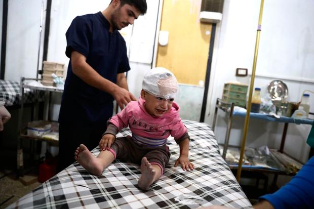 A child is treated at a make-shift hospital after shelling on the rebel-held town of Douma yesterday. Photo: Abd Doumany/Getty Images