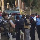 US embassy staff and Kenyan security forces in Nairobi following the attack (AP)