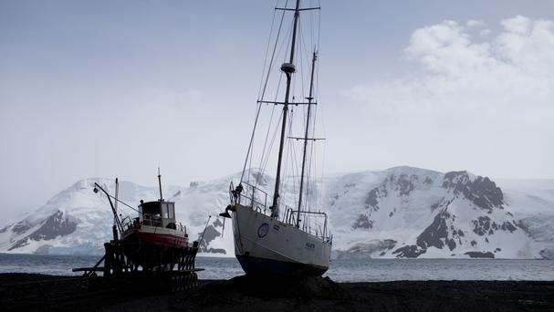 Boats sit on the beach at Bahia Almirantazgo in Antarctica (AP)