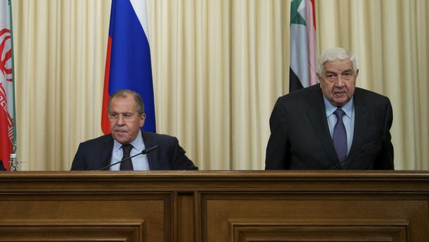 Russian foreign minister Sergey Lavrov and Syrian counterpart Walid al-Moallem after their meeting in Moscow (AP)