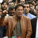 Imran Khan addresses supporters rallying in Islamabad in defiance of a government-imposed ban on demonstrations (AP)