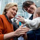 Democratic presidential candidate Hillary Clinton greets a woman and a baby outside the Leonard J. Kaplan Center for Wellness at the University of North Carolina at Greensboro in Greensboro, N.C.
