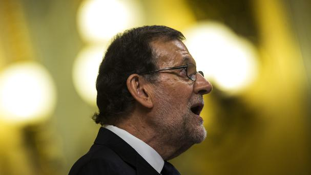 Mariano Rajoy has won a second term as prime minister (AP)